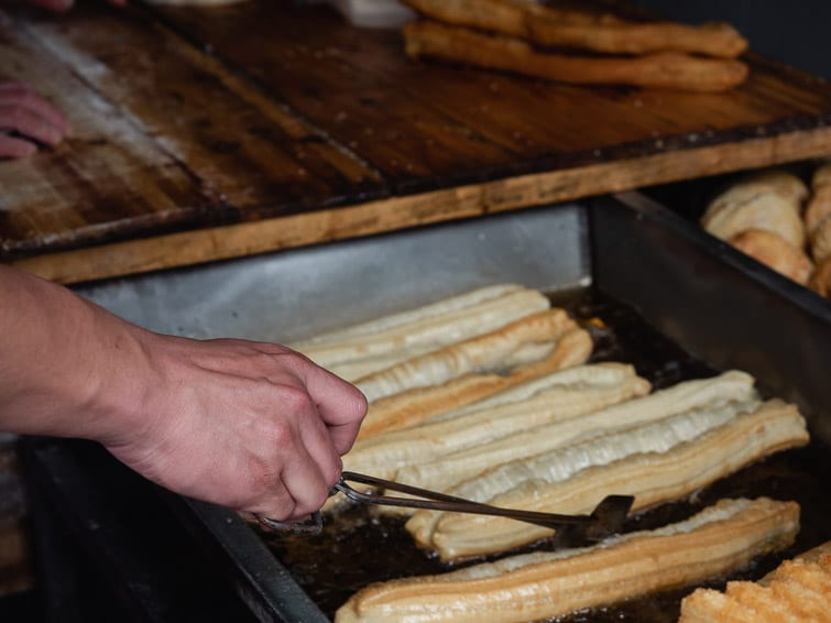 Cooking Youtiao Fried Dough Sticks